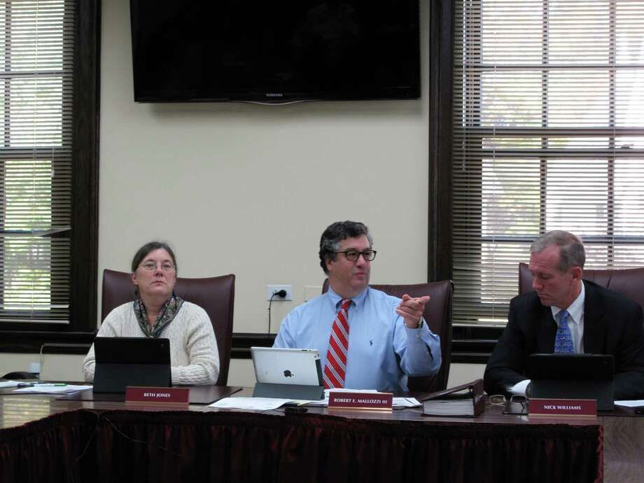 Selectmen Beth Jones, Robert Mallozzi, and Nick Williams listen to the pension report at the Board of Selectmen meeting on Tuesday morning, Oct. 16. Photo: Tyler Woods