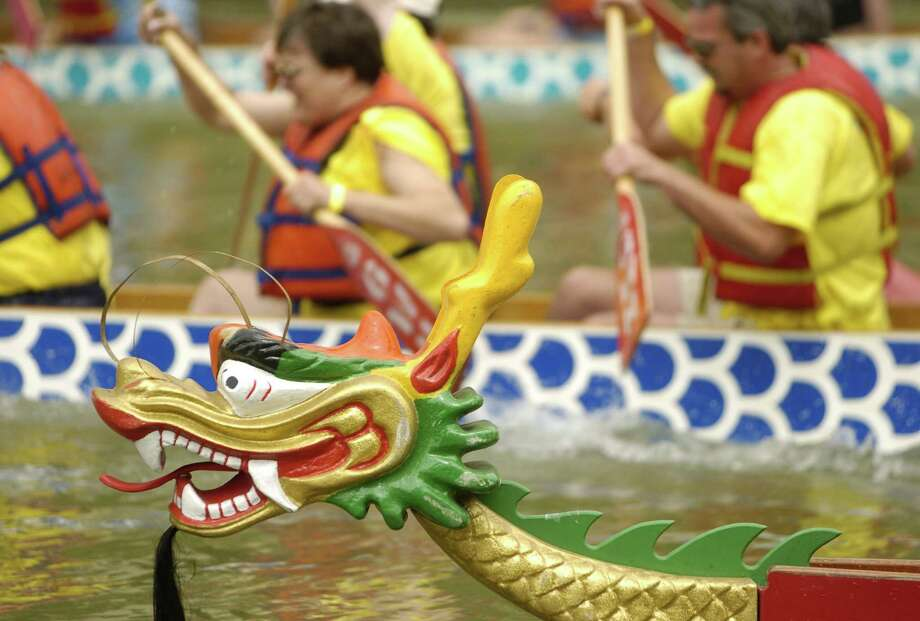 The Dragon Boat Regatta features colorful boats and plenty of family-friendly activities. Photo: MELISSA PHILLIP / HOUSTON CHRONICLE