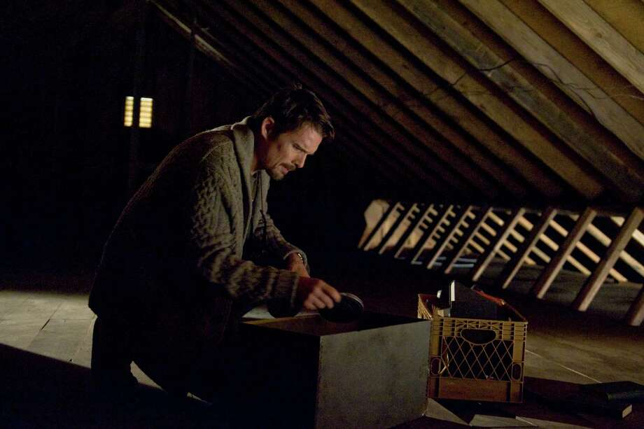 """This film image released by Summit Entertainment shows Ethan Hawke in a scene from """"Sinister."""" (AP Photo/Summit Entertainment, Phil Caruso) Photo: Phil Caruso / Summit Entertainment"""