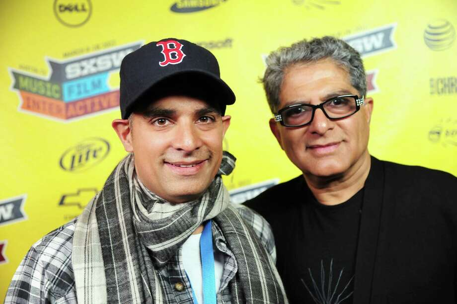 "AUSTIN, TX - MARCH 11:  Filmmaker Gotham Chopra and Dr. Deepak Chopra attend ""Decoding Deepak"" Greenroom Photo Op during the 2012 SXSW Music, Film + Interactive Festival at Paramount Theatre on March 11, 2012 in Austin, Texas.  (Photo by Karl Walter/Getty Images for SXSW) Photo: Karl Walter / 2012 Getty Images"