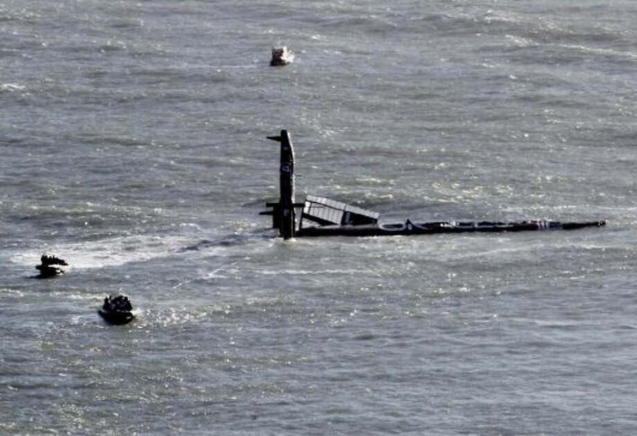 A 72 foot Oracle vessel training for the America's Cup, capsized in San Francisco Bay Tuesday Oct. 16, 2012 and currents carried it out into the ocean. While some of the crew members were thrown into the water, all were accounted for and there are no serious injuries, according to a statement released by the syndicate. (AP Photo/Brant Ward, San Francisco Chronicle) (Associated Press)