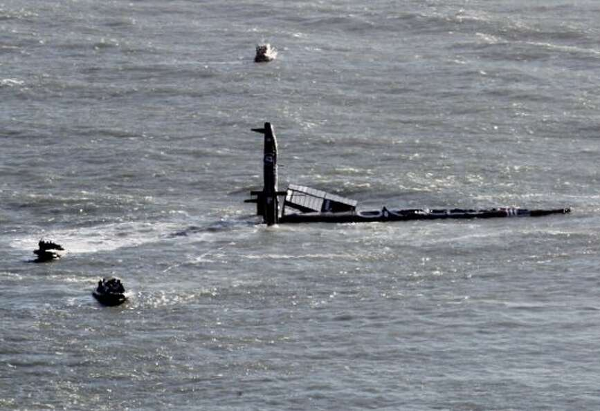 A 72 foot Oracle vessel training for the America's Cup, capsized in San Francisco Bay Tuesday Oct. 1