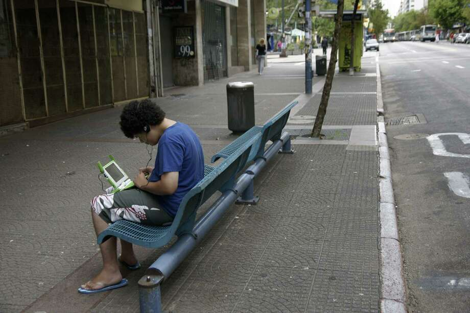 Are we lonely?Seattle tied for highest rate of men living alone among non-family households. So maybe our frosty reputation comes from spending so much time alone (and studying for college and paying off those student loans).  Photo: PANTA ASTIAZARAN, . / 2010 AFP