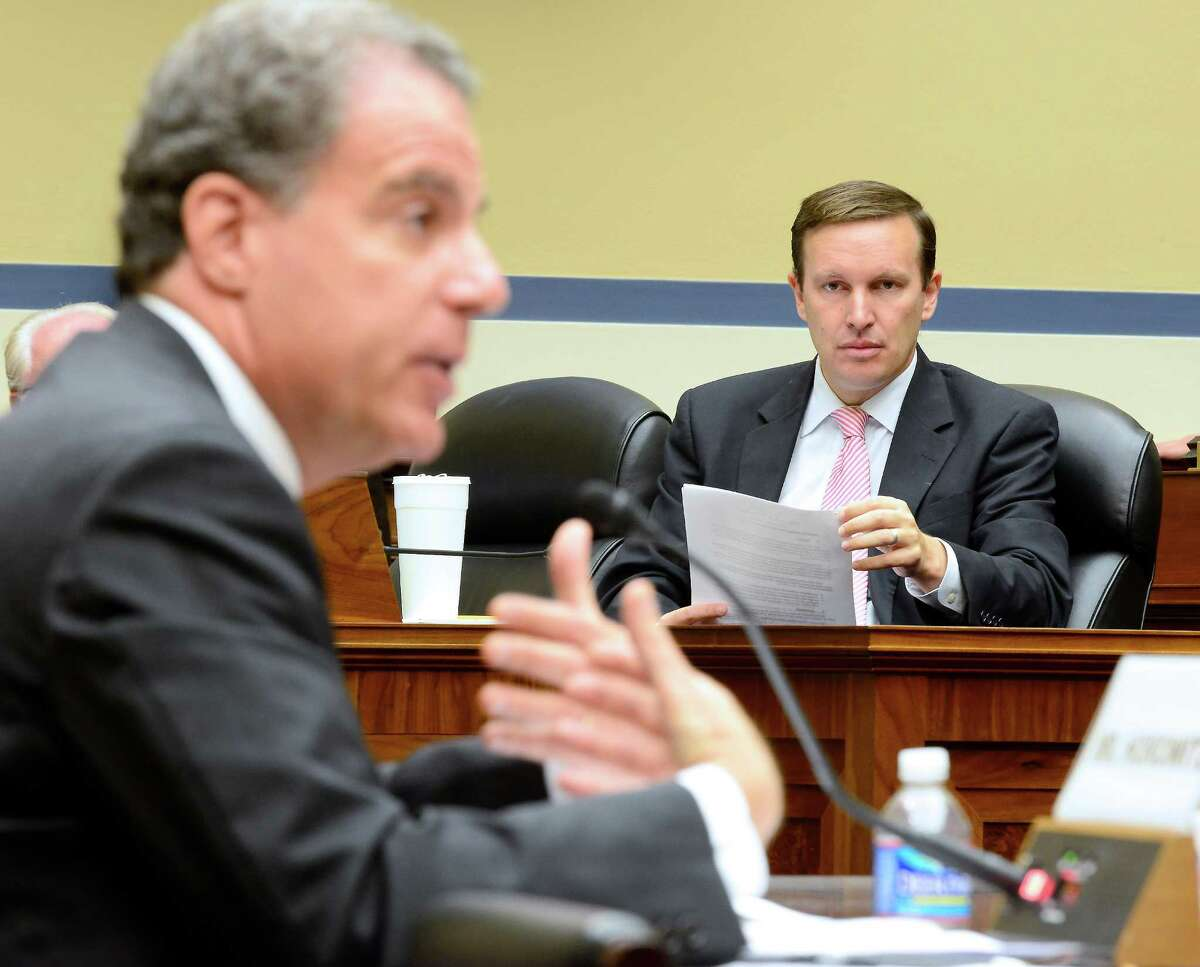 U.S. Rep. Chris Murphy (D-Conn) listens to the testimony of the U.S. Department of Justice's Inspector General Michael Horowitz, left, at a hearing of the U.S. House Committee on Oversight and Government Reform on Operation Fast and Furious in Washington, D.C. on Thursday, September 20, 2012.