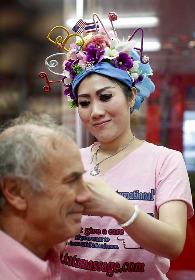 "Tata demonstrates ""ancient Thai art of face slapping"" on Steve Rubenstein at her massage parlor on Geary Boulevard in San Francisco. Photo: Russell Yip, The Chronicle"