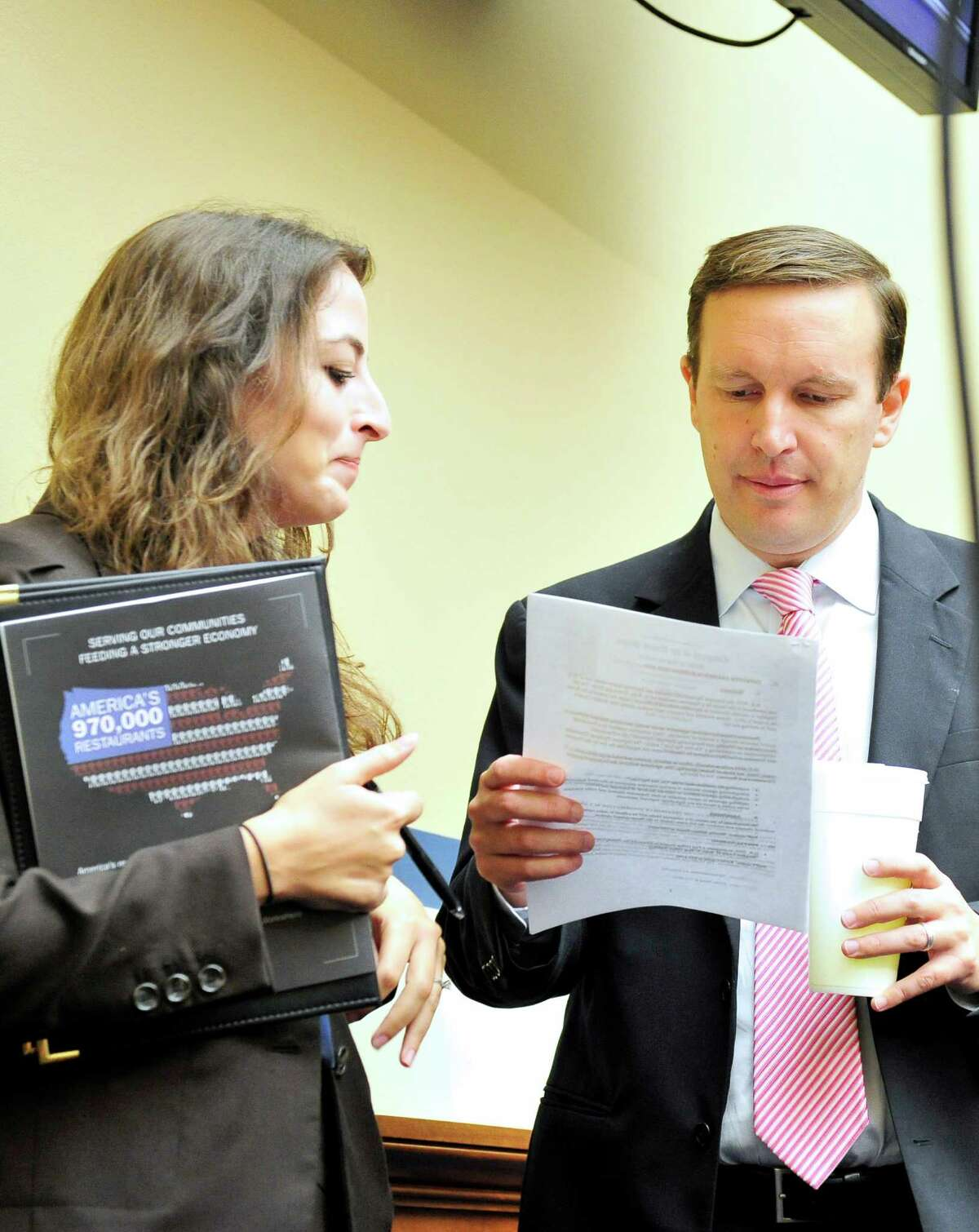 U.S. Rep. Chris Murphy (D-Conn.) goes over his notes with Linda Forman Naval, Legislative Assistant, as he arrives for a hearing of the U.S. House Committee on Oversight and Government Reform on Operation Fast and Furious in Washington, D.C. on Thursday, September 20, 2012.