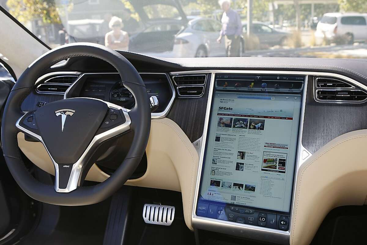 Tesla's new Model S has a fully digitized panel with huge monitor at right at the Tesla dealership in Menlo Park, Calif., on Tuesday, October 16, 2012.