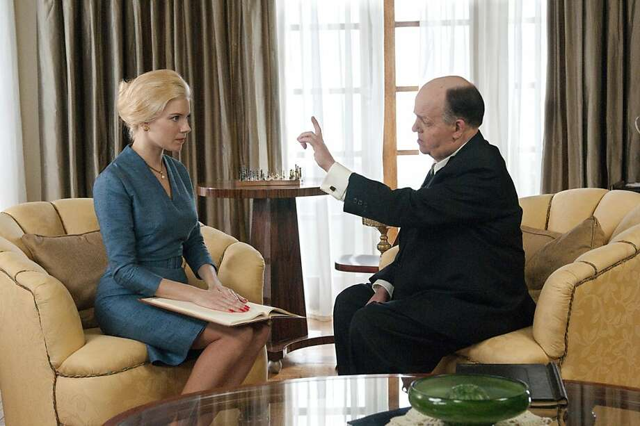 "Actress Tippi Hedren (Sienna Miller) engages in a battle of wills with director Alfred Hitchcock (Toby Jones) in HBO's ""The Girl."" Photo: Kelly Walsh, HBO"