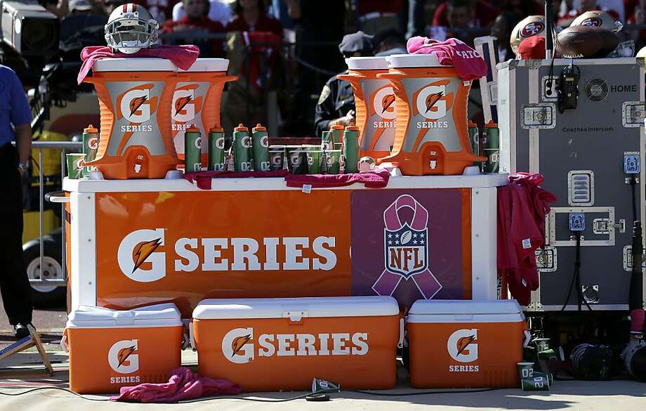 It doesn't matter what's on the inside of these coolers on the sideline of the 49ers-Giants game on Sunday at Candlestick Park. What matters is what's on the outside: a Gatorade logo. Photo: Marcio Jose Sanchez, Associated Press