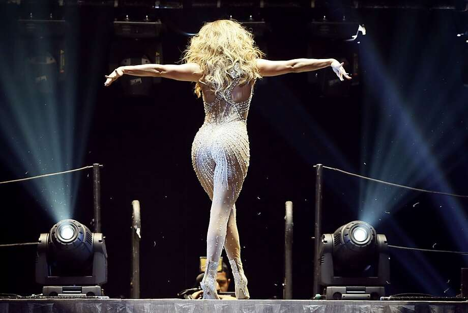 Gossamer threads:JLo shimmers in a nearly see-through number during her concert at the Bercy in Paris. Photo: Kenzo Tribouillard, AFP/Getty Images