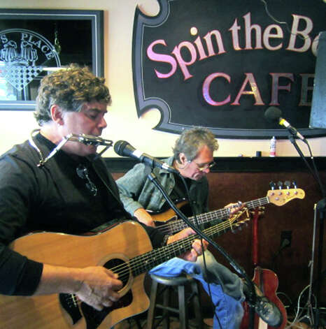 Mike Latini, left, and Jim Novak perform for a crowd in the Spin the Bottle Cafe at Daniel's Dining Car on Railroad Street during the Greater New Milford Chamber of Commerce's Harvest Festival, Oct. 7, 2012 in the New Milford village center. Musical entertainment was offered at Daniel's Dining Car and at Sole Cafe because threatening weather caused event organizers to cancel outdoor performances on Bank Street. Photo: Norm Cummings