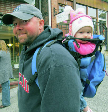 Olivia Fletcher, 2, of Litchfield is all bundled up for the chilly autumn weather but curious about all around her as she investigates the Greater New Milford Chamber of Commerce's Harvest Festival with her dad, Jon Fletcher, Oct. 7, 2012 in the New Milford village center. Photo: Norm Cummings