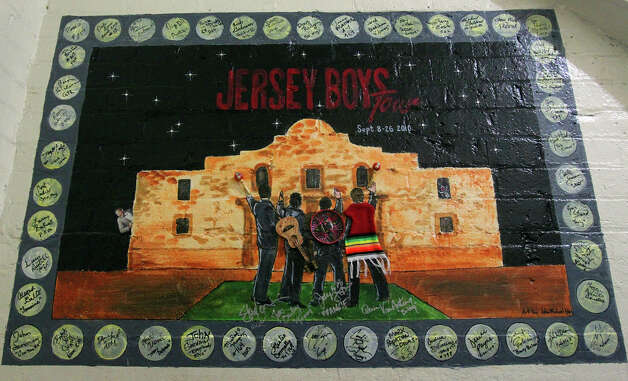 The the mural at the Majestic Theater for the production of Jersey Boys took on a familiar local theme. The murals are at both the Majestic Theater and the Charline McCombs Empire Theater. Photo: John Davenport, San Antonio Express-News / San Antonio Express-News