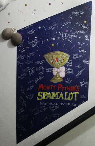 The mural of the production of Monty Python's Spamalot is on a stairwell at the Majestic Theater and comes complete with coconut shells (upper left). The images can be found at both the Majestic Theater and the Charline McCombs Empire Theater. Photo: John Davenport, San Antonio Express-News / San Antonio Express-News