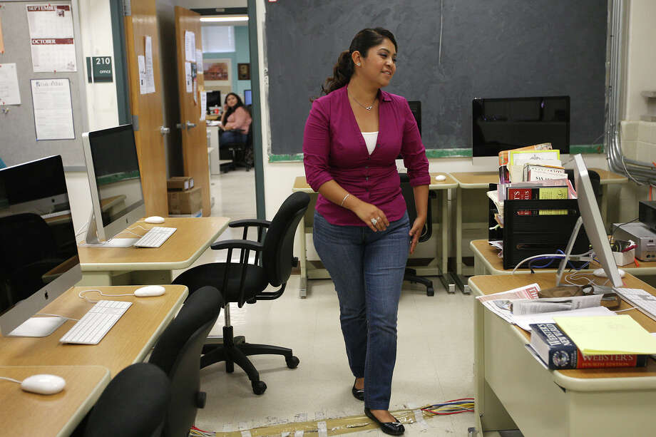 San Antonio College student Lucia Espino works at the school's newspaper, Wednesday, Oct. 17, 2012. Espino, 23, came with her family from Mexico City in 2001 and qualifies for the Barack Obama's deferred action. During last night's debate between Mitt Romney and Obama, Romney announced if elected president, students can keep their deferred action status. Photo: JERRY LARA, San Antonio Express-News / © 2012 San Antonio Express-News