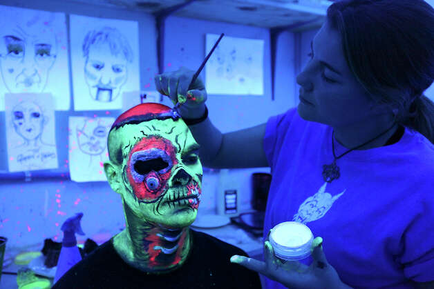 Makeup artist Shauna Burns, 23, applies zombie makeup to actor David Hernandez, 29, Sunday Oct. 14, 2012 at Nightmare on Grayson. Photo: Edward A. Ornelas, San Antonio Express-News / © 2012 San Antonio Express-News