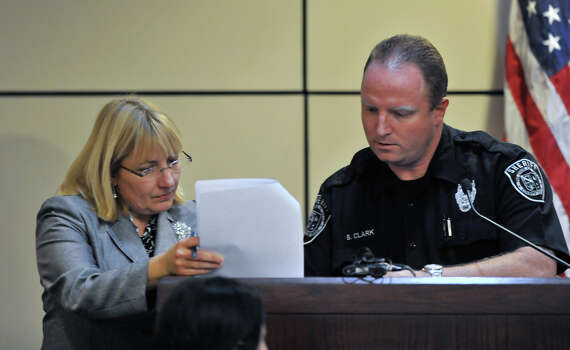 Prosecuting attorney Jan Ishy discusses a document  with sheriff deputy Brian Clark. Clark is a witness in the sentencing phase of the  capital murder trial of James Morrison. Photo: Robin Jerstad, For The Express-News