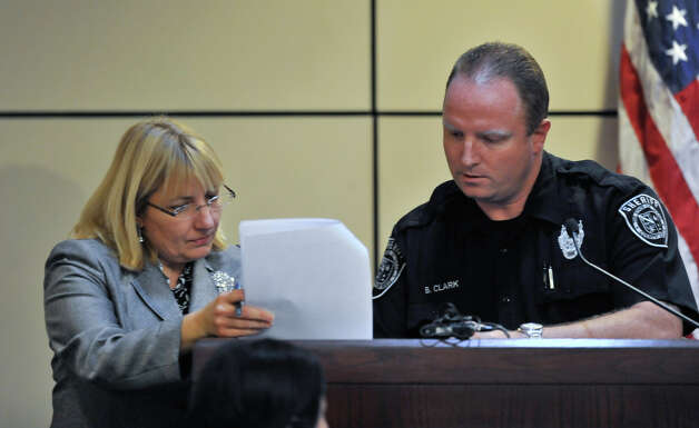 Prosecuting attorney Jan Ishy discusses a document  with Deputy Brian Clark on Monday, Oct. 15, 2012. Clark is a witness in the sentencing phase of the  capital murder trial of James Morrison. Photo: Robin Jerstad, For The Express-News