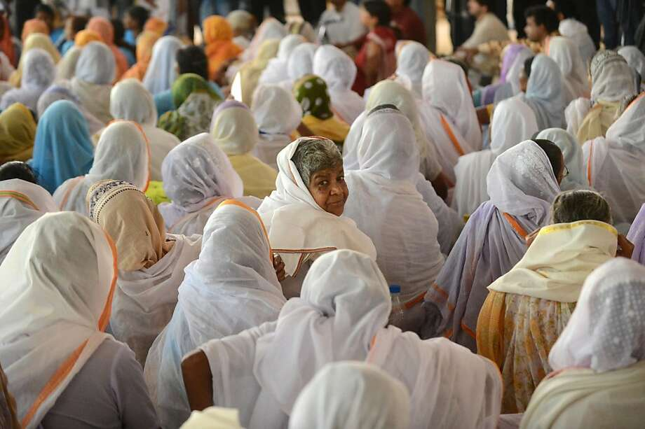 Some of the 15,000 widows from Vrindavan attend an event to offer some help to them in New Delhi. Photo: Raveendran, AFP/Getty Images