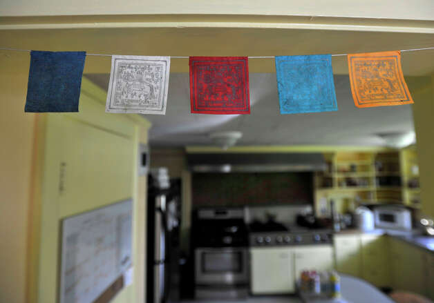 Prayer flags adorn the doorway between the dining room and the kitchen at the Do Ngak Kunphen Ling Tibetan Buddhist Center and monastery in Redding on Wednesday, Oct. 10, 2012. Photo: Jason Rearick / The News-Times