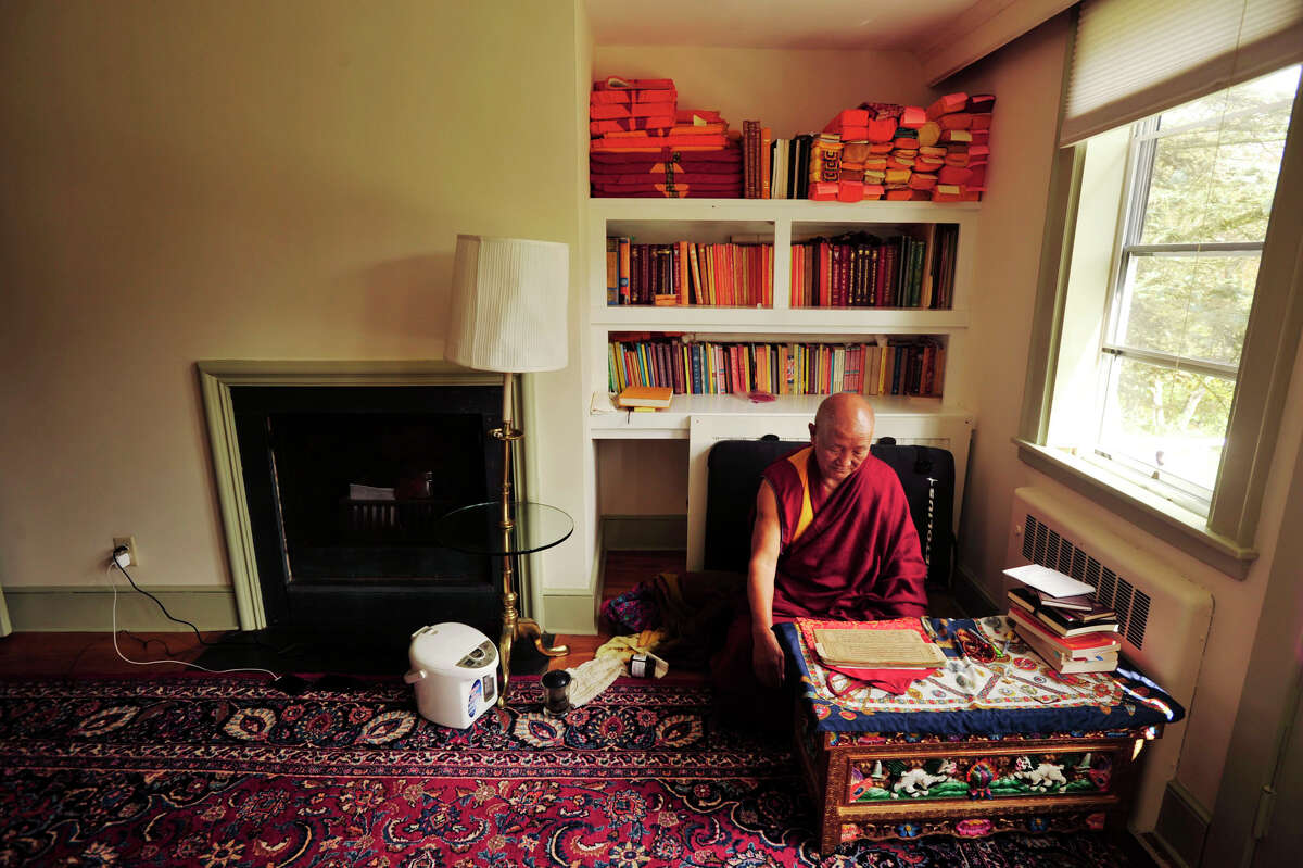 Guymed Khensur Lobsang Jampa reads a mind training book at the Do Ngak Kunphen Ling Tibetan Buddhist Center and monastery in Redding on Wednesday, Oct. 10, 2012.