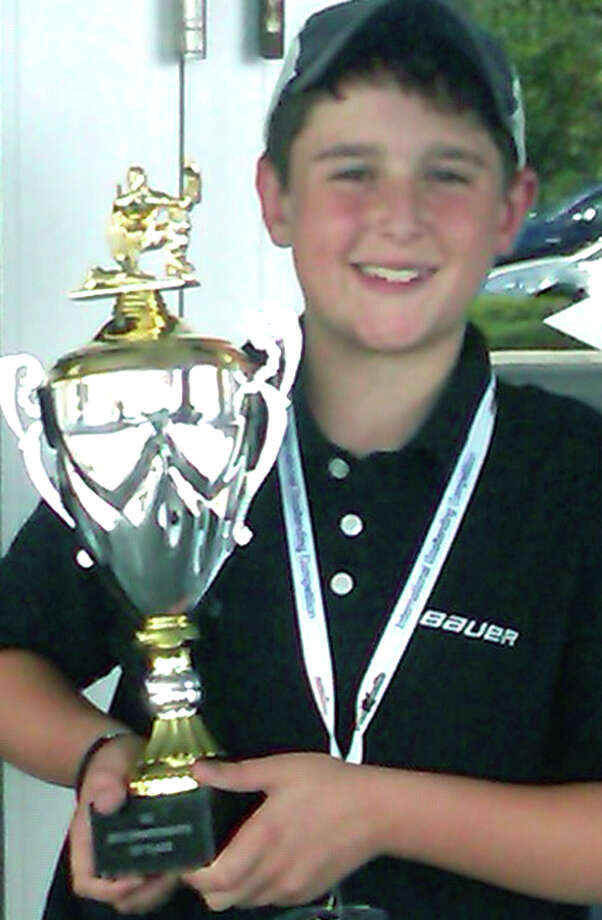 Nicholas Toth of New Milford proudly displays the trophy he earned for winning first place at the International Goaltender Competition in Orlando, Fl. this summer. 2012   Courtesy of the Toth family Photo: Contributed Photo