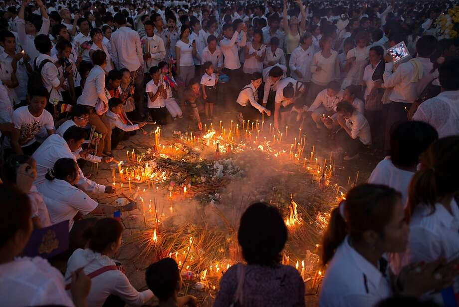 Mourners burn incense and offer prayers at the Royal Palace as the body of the late King Norodom Sihanouk returned in Phnom Penh on October 17, 2012. Tens of thousands of mourners lined the streets of the Cambodian capital on October 17 to pay their last respects to revered former king Norodom Sihanouk on his final journey home from China. Photo: Nicolas Asfouri, AFP/Getty Images
