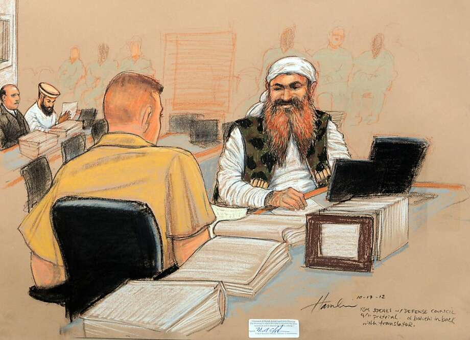 In this photo of a sketch by courtroom artist Janet Hamlin and reviewed by the U.S. Department of Defense, Khalid Sheikh Mohammed, right, speaks with lawyer and U.S. Marine Corps Reserve Major Derek Poteet, a member of his legal team, while wearing a camouflage vest during the third day of the Military Commissions pretrial hearing against the five Guantanamo prisoners accused of the Sept. 11 terrorist attacks at the Guantanamo Bay U.S. Naval Base in Cuba, Wednesday, Oct. 17, 2012. Khalid Sheikh Mohammed, who has told authorities he was the mastermind of the Sept. 11 hijacking plot, wore the woodland-style camouflage vest for the first time Wednesday, a clothing choice previously denied because of fears it might disrupt the court. Co-accused Ali Abd al-Aziz Ali is seen in the background, second from left. (AP Photo/Janet Hamlin, Pool) Photo: Janet Hamlin, Associated Press