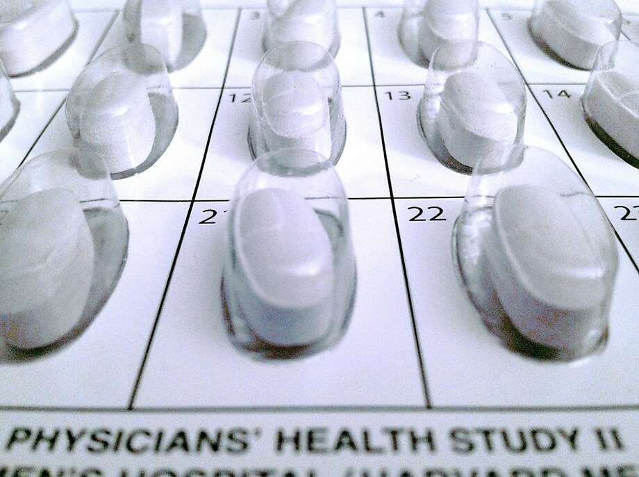This Oct. 11, 2012 photo provided by the Brigham and Women's Hospital shows a monthly calendar vitamin pack used in a long-term study on multivitamins. America's favorite dietary supplements, multivitamins, modestly lowered the risk of developing cancer in healthy male doctors who took them daily for more than a decade, the first large study to test these pills has found. The study was published online in the Journal of the American Medical Association on Wednesday, Oct. 17, 2012. (AP Photo/Brigham and Women's Hospital) Photo: Associated Press