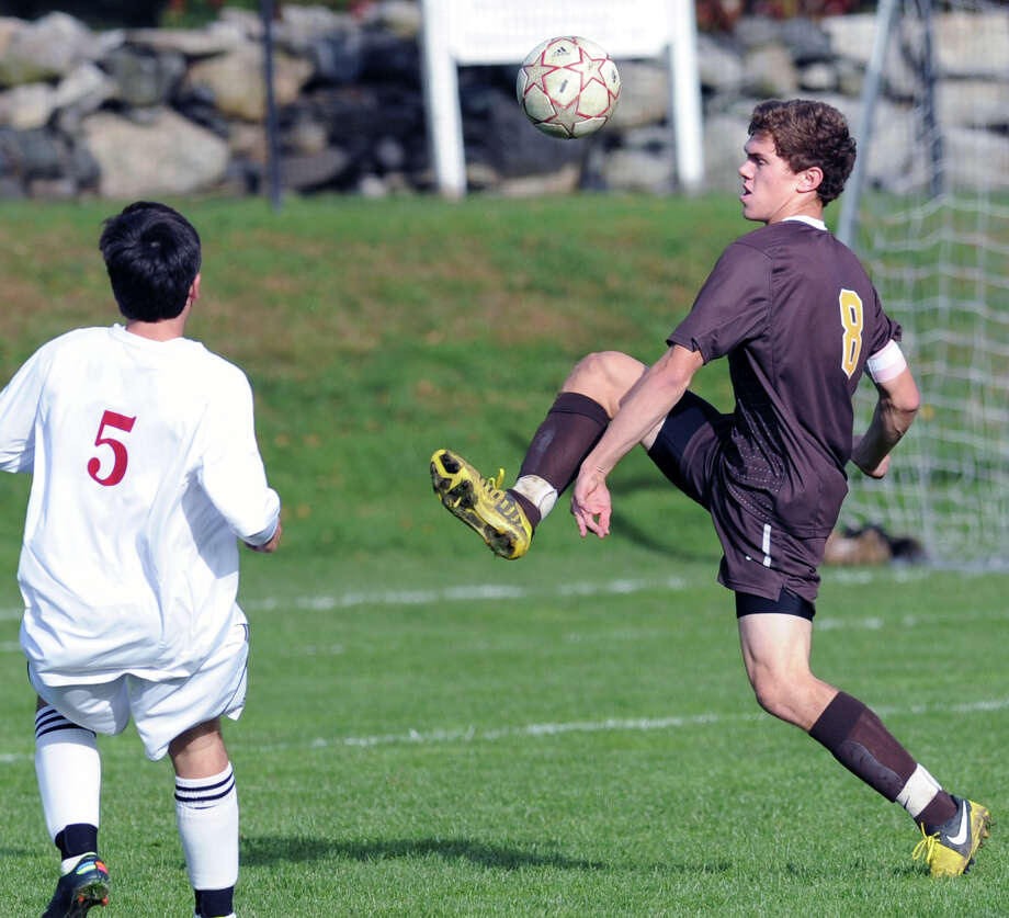 At right, Peter Khoury # 8 of Brunswick advances the ball while being defended by Dimitrios Floros # 5 of Salisbury during the boys high school soccer match between Brunswick School and Salisbury School at Brunswick in Greenwich, Wednesday afternoon, Oct. 17, 2012. Photo: Bob Luckey / Greenwich Time