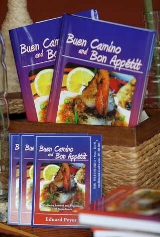"Eddie Peyer's newly published book ""Buen Camino and Bon Appetit"" is seen Wednesday Oct. 17, 2012. Photo: William Luther, San Antonio Express-News / © 2012 San Antonio Express-News"
