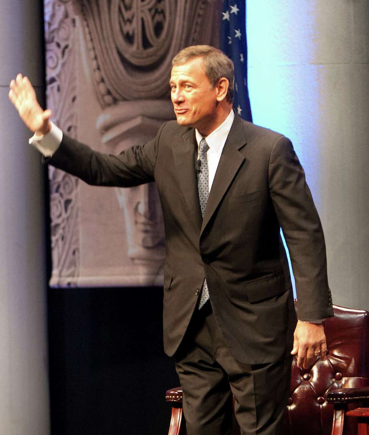 Chief Justice of the United States, John G. Roberts Jr., waves before