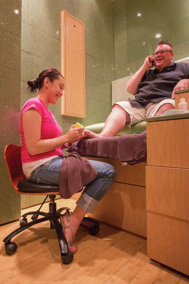 Underbelly executive chef, Chris Shepherd, gets a pedicure by Michelle Nguyen, Wednesday, May 23, 2012, at Isle PediSpa in Houston, Texas. (TODD SPOTH FOR THE CHRONICLE) Photo: TODD SPOTH / © TODD SPOTH, 2012