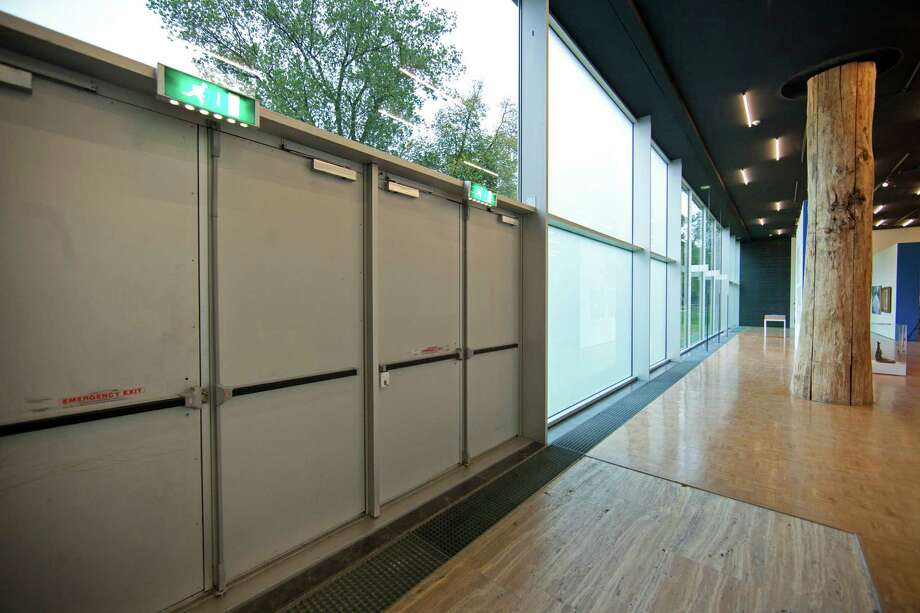 The exit doors used to take seven stolen paintings out of Kunsthal museum are seen in Rotterdam, Wednesday Oct. 17, 2012, as the museum opened it's door to the public following early Tuesday morning's heist. Police investigating a multimillion euro (dollar) art heist say they are following up several tips from the public, a day after thieves grabbed seven paintings from the walls of a Rotterdam gallery and vanished into the night. A spokeswoman for detectives on the case, Willemieke Romijn, said Wednesday they have some 15 tips from the public, following a late-night, nationally televised appeal for witnesses to the theft from the Kunsthal gallery of works by celebrated artists including Pablo Picasso, Claude Monet and Henri Matisse. (AP Photo/Peter Dejong) Photo: Peter Dejong / AP