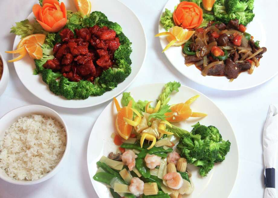 Top left :General Tso's Chicken, Jalapeno beef and bottom is Shrimp with vegetables all served at House of Joy. Photo: JUANITO M GARZA, San Antonio Express-News / San Antonio Express-News