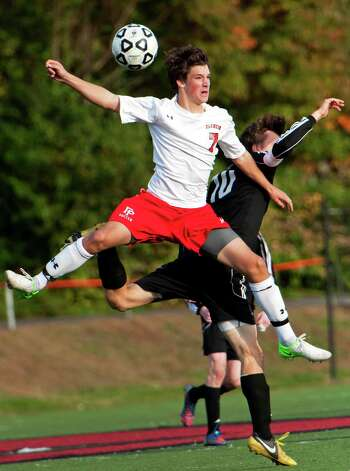 Fairfield Prep high school's Tim Frassetto heads the ball in a boys soccer game against Daniel Hand high school held at Fairfield Prep, Fairfield, CT on Wednesday October 17th, 2012. Photo: Mark Conrad / Connecticut Post Freelance
