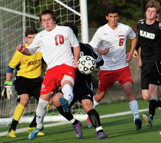 Fairfield Prep high school' David Bruton tries to clear the ball out from in front of his teams goal in a boys soccer game against Daniel Hand high school held at Fairfield Prep, Fairfield, CT on Wednesday October 17th, 2012. Photo: Mark Conrad / Connecticut Post Freelance