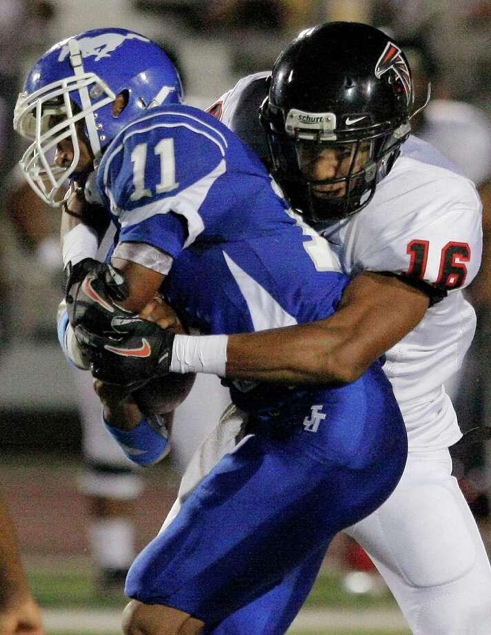 Stevens' Dominique Williamson, right, takes down John Jay's Josh Reynolds during a District 27-5A high school football game, Friday, Sept. 23, 2011, at Gustafson Stadium in San Antonio. Photo: Darren Abate, For The Express-News