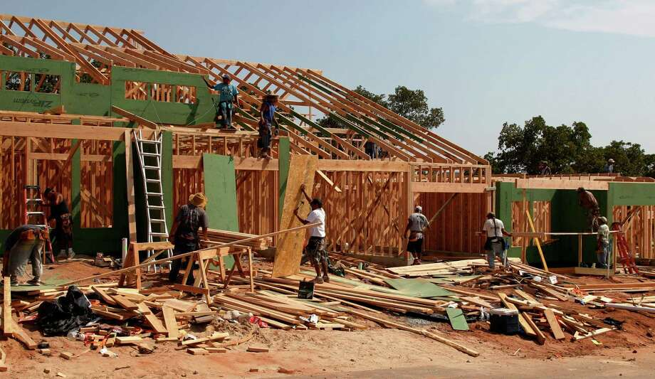 In this Friday, Sept. 21, 2012, photo, new homes are constructed in Edmond, Okla. U.S. builders started construction on single-family homes and apartments in September at the fastest rate since July 2008, a further indication that the housing recovery is strengthening. The Commerce Department said Wednesda, Sept. 17, 2012,  that builders broke ground on homes at a seasonally adjusted annual rate of 872,000 in September. That's an increase of 15 percent from the August level. (AP Photo/Sue Ogrocki,) Photo: Sue Ogrocki / AP