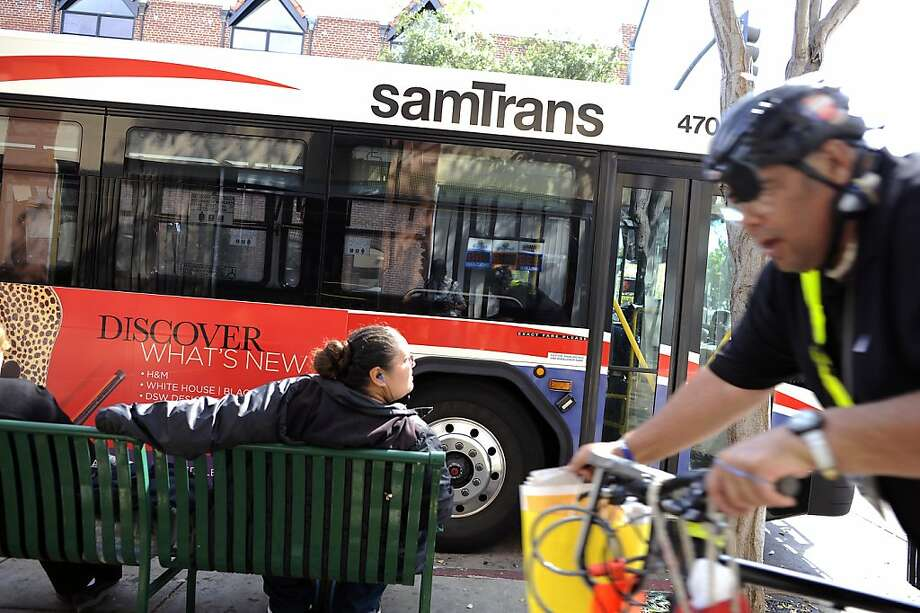 Passengers wait for an off-duty SamTrans bus to go into service at First Avenue and B Street in downtown San Mateo. Photo: Michael Short, Special To The Chronicle