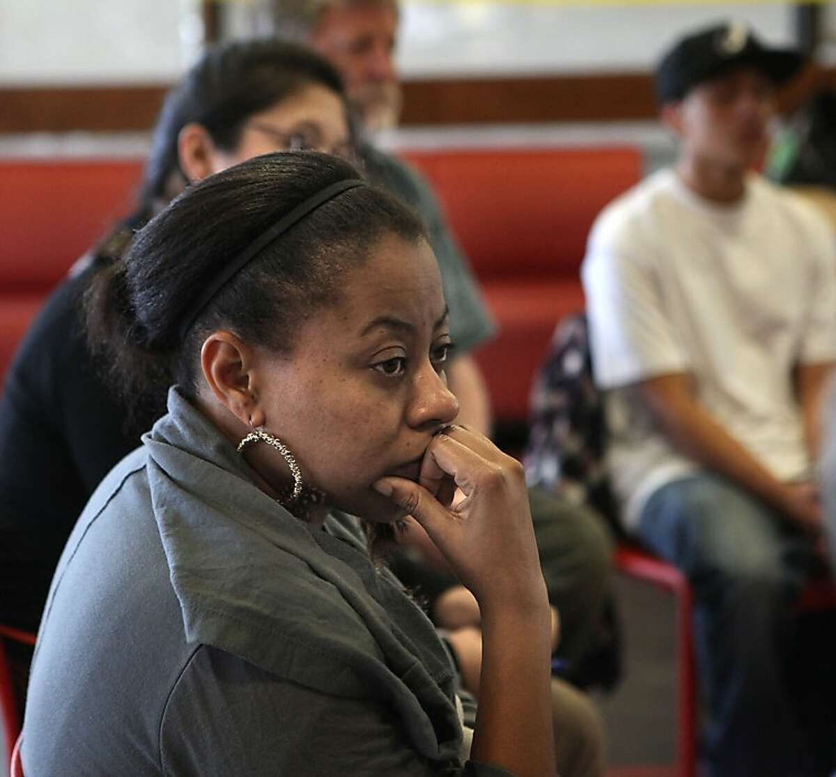 Student and organizer Shanell Williams listens to people's concerns in a meeting of The Save CCSF coalition in a lounge at CCSF student union in San Francisco, Calif., on Wednesday, October 10, 2012.