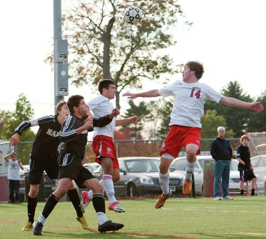Fairfield Prep high school's Darragh Kelly tries to control the ball in frond on the Daniel Hand high school goal in a boys soccer game held at Fairfield Prep, Fairfield, CT on Wednesday October 17th, 2012. Photo: Mark Conrad / Connecticut Post Freelance