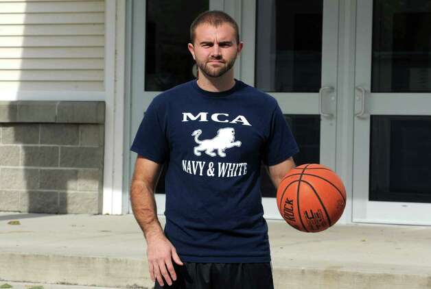 Mekeel Christian Academy teacher Matt McCarty will dribble a basketball while running his first marathon this weekend, and he'll dribble a basketball the entire time to raise awareness and money for a charity in Haiti in Scotia, NY Wednesday Oct. 17, 2012. (Michael P. Farrell/Times Union) Photo: Michael P. Farrell