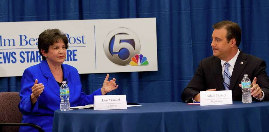 Lois Frankel, Democratic candidate for Florida 22nd Congressional district, and Republican candidate Adam Hasner answers question during their debate in West Palm Beach, Fla., Wednesday, Oct. 17, 2012. It's fair to say Hasner has a thick book of opposition research in his heated U.S. House race. Hasner, who is running against former West Palm Beach Mayor Frankel, has an unusual history with his opponent ? his mother used to be her campaign manager. Hasner, a charismatic former Florida House majority leader and son of two staunchly Democratic teachers, and Frankel, a feisty former public defender and mother of an Iraqi war veteran, are battling in a newly drawn district stretching from Boca Raton to Fort Lauderdale that tilts Democratic.(AP Photo/J Pat Carter) Photo: J Pat Carter / AP