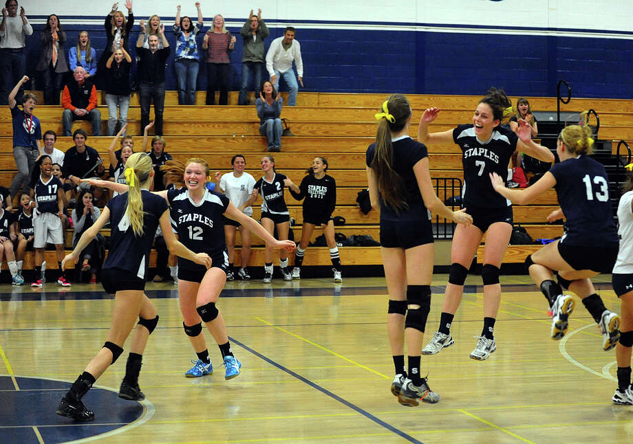 Staples celebrates its win over Stamford, during girls volleyball action in Westport, Conn. on Wednesday October 17, 2012. Photo: Christian Abraham / Connecticut Post