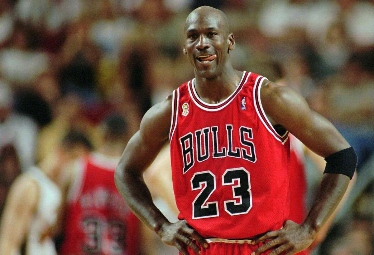 In this June 9, 1996 file photo Chicago Bulls Michael Jordan stands during a break at the end of an NBA Basketball game against the Seattle SuperSonics in Seattle.(AP Photo/Beth A. Keiser, File)