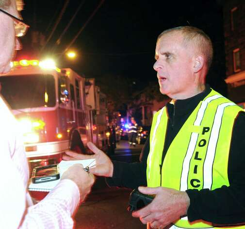 Greenwich Police Chief James Heavey speaks at the scene of an incident in which a man suffered a severe head injury after being hit by a train along the Metro-North Railroad tracks near the Davis Drive overpass in the area of Bruce Park Avenue Extension, Greenwich, Wednesday night, Oct. 17, 2012. Photo: Bob Luckey / Greenwich Time