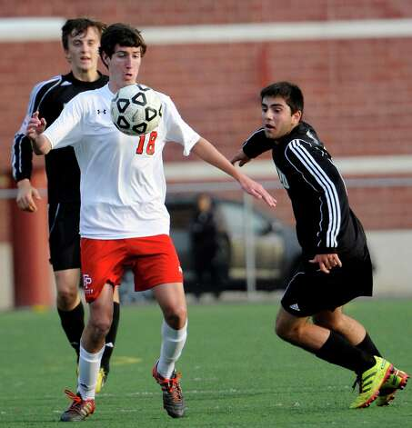 Fairfield Prep high school's Jordan Visosky tries to control the ball in a boys soccer game against Daniel Hand high school held at Fairfield Prep, Fairfield, CT on Wednesday October 17th, 2012. Photo: Mark Conrad / Connecticut Post Freelance