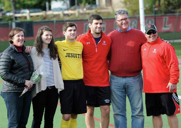 Fairfield Prep high school's William Steiner (third from left) his family and the Prep head boys soccer coach Ryan Lyddy pose for a photo during a pre game senior day event held before Preps game against Daniel Hand high school at Fairfield Prep, Fairfield, CT on Wednesday October 17th, 2012. Photo: Mark Conrad / Connecticut Post Freelance