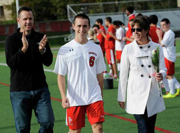 Fairfield Prep high school' Pat Connolly and family during a senior day event held prior to the boys soccer game against Daniel Hand high school held at Fairfield Prep, Fairfield, CT on Wednesday October 17th, 2012. Photo: Mark Conrad / Connecticut Post Freelance